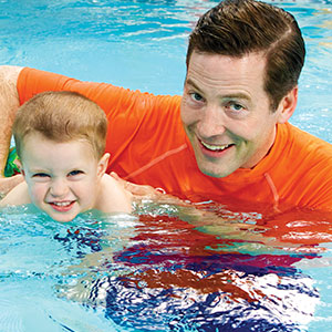 Swimming lessons in okemos beginner swimming program swim school for Levittown pools swimming lessons